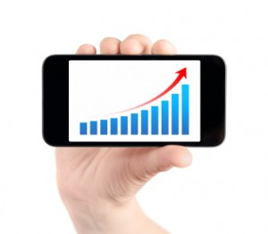 Hand Showing Mobile Phone With Success Chart