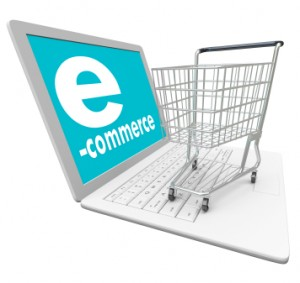 A laptop computer with the word e-Commerce on the screen